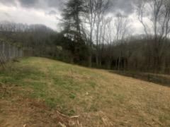 Rare chance to own property near the lake and yet close to town!! This land would be perfect to build your dream home on, and enjoy being close to the lake and have privacy that is hard to find. The land lays nice and has an old tennis court and basketball court on it. At one time there was water and electric on this property. Come take a look today.
