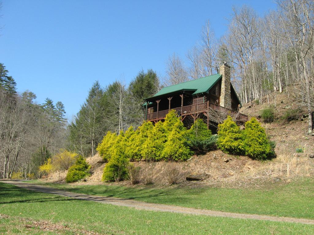 BEAUTIFUL LOG HOME IN A PARK LIKE SETTING ON A BOLD CREEK WITH FIVE ACRES OF LAND.  MAIN FLOOR FEATURES A GREAT ROOM, KITCHEN, DINING AREA, LAUNDRY, MASTER BEDROOM WITH FULL BATH, AND A HALF BATH FOR GUESTS.  UPPER LEVEL FEATURES A LARGE BEDROOM, A FULL BATH, AND A LOFT.  LOWER LEVEL FEATURES A HUGE BEDROOM, FAMILY/GAME ROOM, A HALF BATH, AND A SHOP/UTILITY AREA.  THIS HOME COMES COMPLETELY FURNISHED.  THE VIEW AND SOUND OF THE CREEK FROM THE CABIN IS SUPERB WITH ALMOST LEVEL ACCESS TO THE WATERS EDGE.  LAUREL MOUNTAIN IS GATED AND HAS A ROAD MAINTENANCE FEE OF $300 PER YEAR.