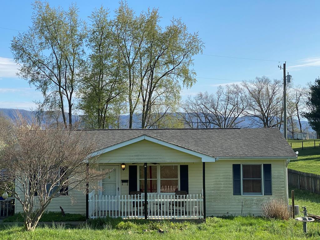 """Beautiful mountain views. Easy access to Alvarado Station, the Virginia Creeper Trail, and outdoor recreation. These are just some of the reasons you will love this rural, one-level ranch-style home. Quick access to historic downtown Abingdon, Damascus, I-81, shopping and more add to the appeal. A side patio area offers afternoon shade from summer sun. The front porch is a great place to sit and relax too. A large back yard has room for installation of a deck or home addition. A barn-like storage building and a tree house lend charm to the back yard. This property would be a perfect home for anyone and great as an investment property too. Properties are not often available in this location. This is your chance to live in a beautiful area in a nice home that needs just a little landscaping and a bit of TLC to make it a real show place. Property to be sold """"as is."""""""