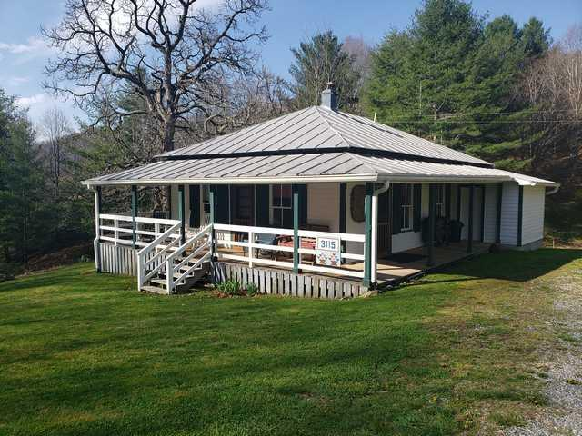 30 Acres w/Charming Cottage Close to Grayson Highlands Park. This 900 square foot cottage overlooks a strong branch in a quiet, peaceful setting. Go back in time as you relax in on the wrap around porch in a rockking chair watching abundant wildlife. The acreage is primarily open and fenced with lots of water, great for livestock. There are lots of mature trees and landscaping including several apple trees. There is plenty of room for a garden and there is an old shed and newer metal building for storing equipment. This property is located in close proximity to Grayson Highlands Park, Jefferson National Forest, the New River, Trout Fishing and all of the recreational opportunities the area has to provide.