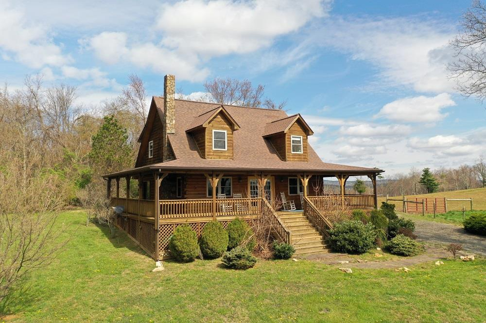 DON'T WAIT.  This fresh and well maintained newer log home is perfectly situated with privacy on 2.5 acres, yet still has nice views and is minutes from downtown Meadows of Dan, Primland Resort and Golf, and many other activities.  The 2008 3 bedroom, 2 bath home is complimented with a wrap around covered porch, large yard and winding driveway.  Master suite on the main floor with large shower and separate jet tub with 2 additional bedrooms on the second level. Located in River Ridge Estates, you and your guests enjoy the HOA Common area with access to a large picnic shelter and and the Dan River.  The property is about half wooded with a large cleared area in the front with large trees.  Beautiful hardwood floors, wood burning stove in the Living room and cathedral ceilings, and doors to the large wrap around porch perfectly compliment the property.  The HOA covers road maintenance. Cable internet through CenturyLink. HOA is $350 Annually