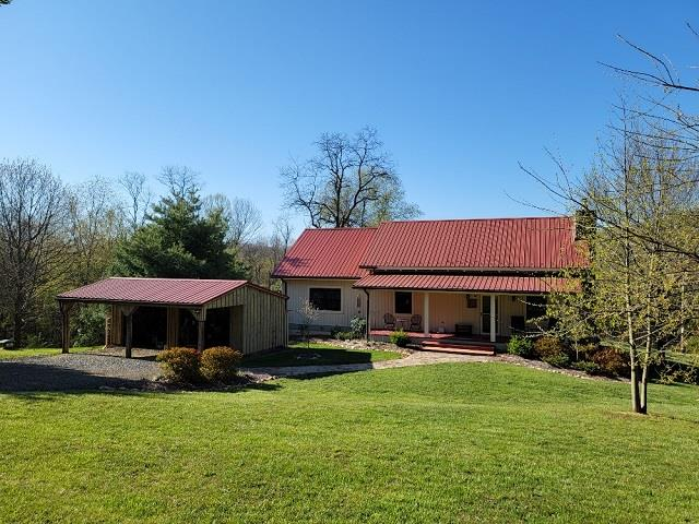 Exceptional, Custom Built Home with 6+ acres located just off the Blue Ridge Parkway! This 2 bedroom, 2 bath home was recently renovated in 2017. Featuring: Open concept living with beautiful kitchen having custom cabinets & quartz countertops, appliances convey. Stone fireplace in living area with wood burning stove, Hardwood and heated tile flooring throughout the main living area. Large master bedroom and bath with tiled steam shower and cast iron tub. Second level has a loft and storage room that could be easily finished for extra bedroom. Heat pump and propane gas furnace, tankless hot water heater & whole house generator installed. Nice size deck and pergola. Outside you have a gorgeous yard with extensive landscaping and well-tendered raised garden beds, asparagus bed and blueberry bushes. Several outbuildings and RV carport.   Also, additional Cabin great for family and friends to visit or potential rental income. Located in a private setting in the Blue Ridge Mountains.