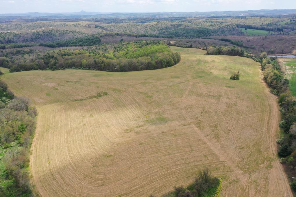 This 134.0486 acres of gently rolling vacant land is located on Coulson Church Road Route 620 just off the exit 19 interchange of I-77 and is within the corporate limits of Carroll County. Beautiful long range views with multiple building sites. This property has road frontage and access from Coulson Church road and the land is approx. 60% cleared. The  Wildwood Commerce Park adjoins this property.  Public water is available in Coulson Church Road and public sewer and natural gas are available in the adjoining Wildwood Commerce Park. This property  is currently zoned agricultural and  in land use and has been used for  crops over the last several years. Could be a development for residential or commercial use.