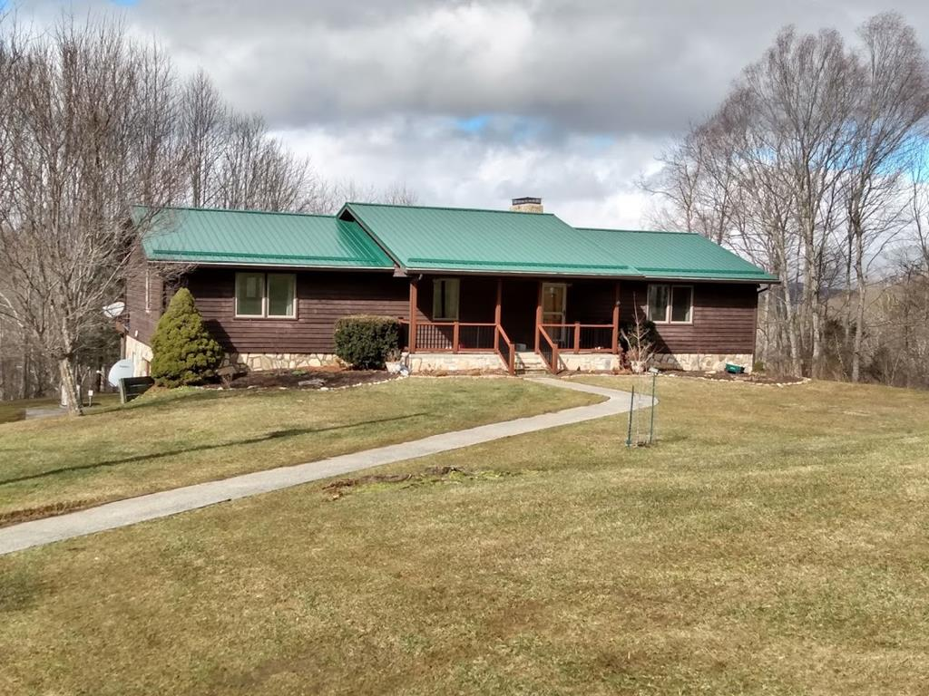 Excellent home on 17.292+/- ac. Seclusion w/long range view & creek w/amazing cascading waterfall. Pond & wooded acreage to roam around. Walk in from the covered front porch into open dining area & living room w/gas log fireplace; windows to enjoy long view; view & sound from the waterfall; & access to open deck which expands entire back of house. Deck is trek flooring, beautiful railings; & stair access to yard. Separate large kitchen w/heated tile floor; island; desk; wine fridge; & breakfast dining area which leads to deck. Large master bedroom w/walk in closet & spacious master bath w/heated tile floor; jet tub; large shower; beautiful cabinetry; & tile work. Main has a 2nd bedroom; laundry closet; & 1/2 bath. Finished basement has spacious family room w/walk out to patio under deck; large bath w/shower w/tile work; kitchen area; 2 extra large rooms 1 w/large walk-in closet. Come view this unique property today & make it your mountain dream home!