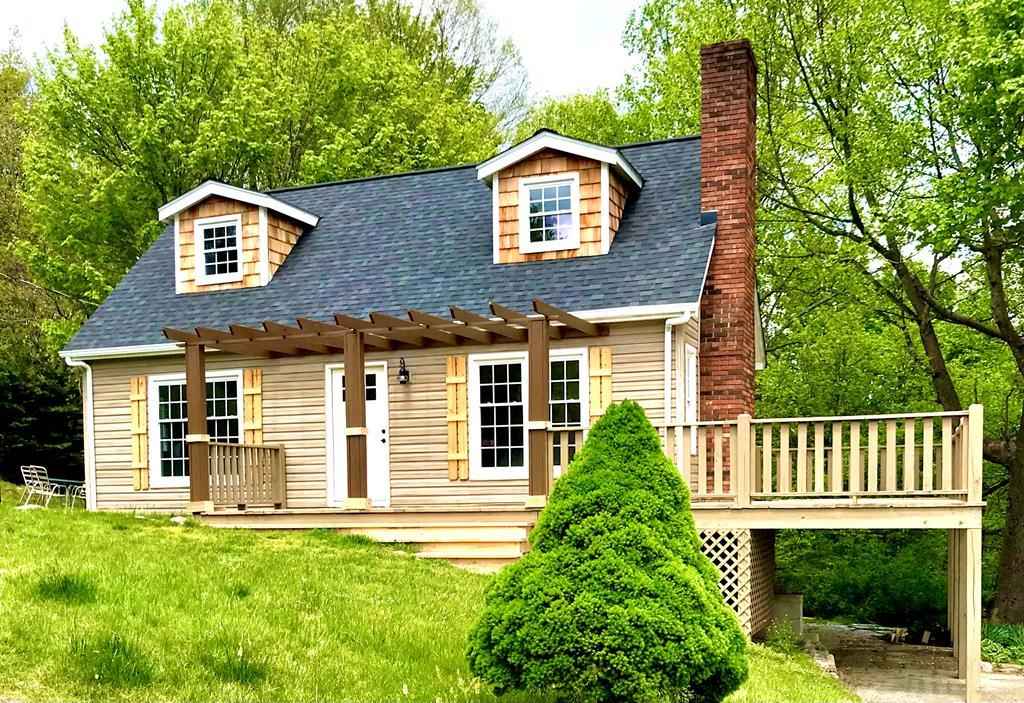 WHAT A RARE OCCURRENCE, a home available in Chalet High, Fancy Gap VA. Available homes with this Piedmont view are almost extinct. This Mountain vacation resort is one of the most desired in the area. The community is located just off of the Blue Ridge Parkway. The main level has been newly renovated, and the renovations to the basement are started for you. Theres plenty of space to add an extra bedroom and gameroom. The house is priced at its current condition. There is a new shingle roof, upgrades to the decking and a new pergola, insulated tilt windows, and cedar shake siding on the dormers, new tongue and groove wood ceilings, bead board walls, fresh paint and new lighting. It features hardwood flooring on most of the main floor, with new water resistant assembled vinyl in the newly renovated kitchen, that includes a gorgeous tile backsplash, and butcher block counter tops. Nothing spared on this top notch kitchen. Stainless appliances, gas range,