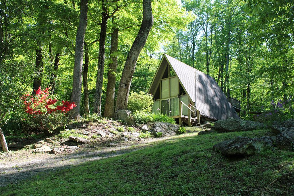 Nice A-frame cabin in a very remote location. Creek with outcropping rock.  624 sq. ft., 2 BR, 1 BA, Nice covered back porch with in 30 ' of the creek. Total of 3 lots. All wheel or 4 wheel drive recommended. HOA is for road maintenance.