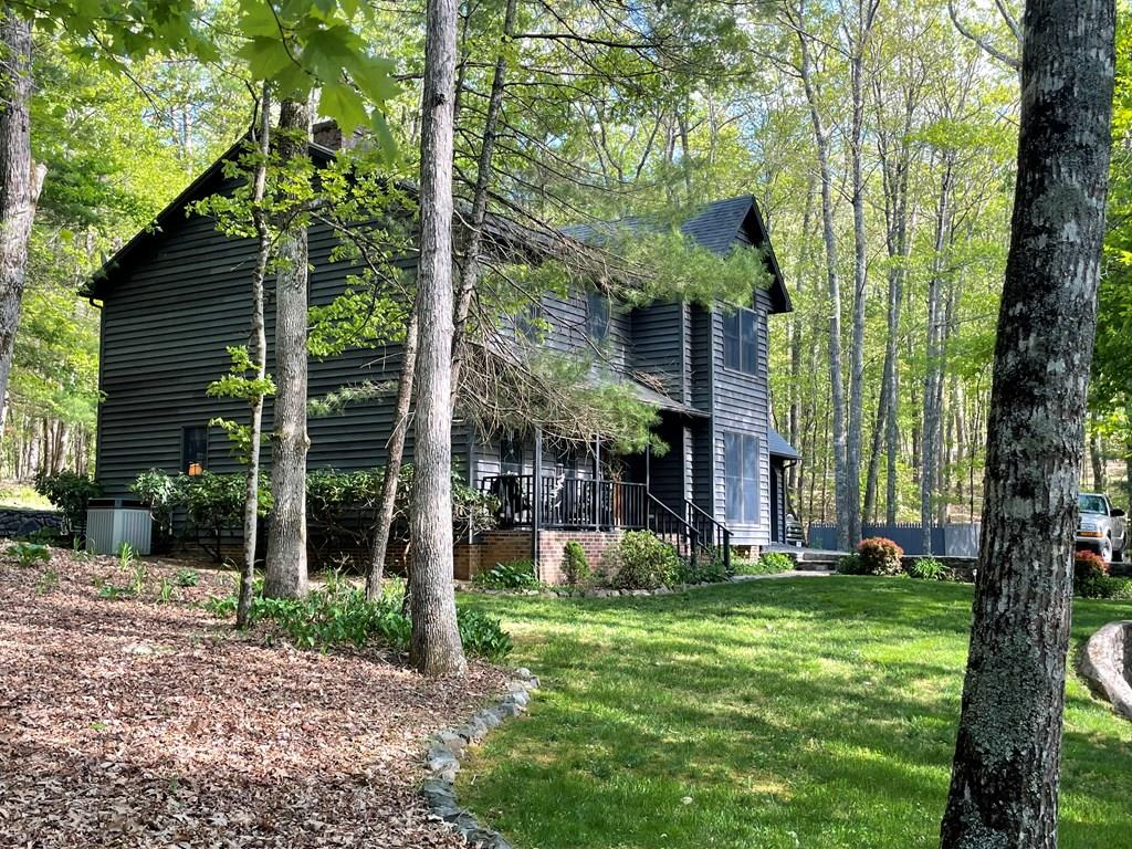 PRIVATE BEAUTY IN OAK KNOLL! This custom built, original owner cedar home is located just outside of Hillsville town limits. Neatly tucked back in the woods on 1.546 acres with a private drive off a cul-de-sac. The main level features a convenient kitchen with breakfast nook on one side and dining room on the other. Both dining areas feature pine floors and large windows overlooking the natural beauty around the home. The living room has an oversized fireplace with gas logs. If you prefer wood heat, an attractive stove on a raised brick hearth is located just off the entrance to the den. The den opens to the rear deck and grounds. A full bath is located adjoining the den. On the upper level, there are 3 bedrooms and two full baths. The generous sized master suite has a large bath with a Cathedral ceiling and Palladian window, walk-in shower, garden tub, and walk-in closet. Rounding out the upstairs is a large bonus room that would be a great gathering place or private office.