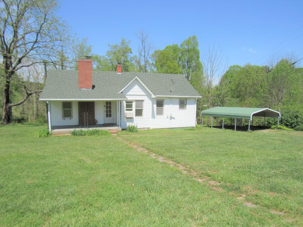 Beautiful acreage and incredibly nice home that is neat as a pin ! Welcome home to this 1028 SF, 2 bedroom 2 bath home on two lots totaling 2.4 acres. Only minutes from the town of Hillsville. Home has a full unfinished basement that is clean to provide buyers with an opportunity to double the size of this affordable home should they decide to finish the basement after they buy it. But WOW what a VALUE and the market is on fire so this one will appeal to a lot of buyers. Perfect for someone looking to downsize, first time home buyers and those that have already sold their home.  Small outdoor firepit and patio area, fruit trees, and grapevines.  A small creek runs along the backside of one of the lots. Laundry on the main level for your convenience. This home has been well taken care of over the years!  New roof in 2019. Up to the buyer's to determine if fireplace can still be used. Owner has never used it.  The home is on county water and private septic. Private & Secluded.