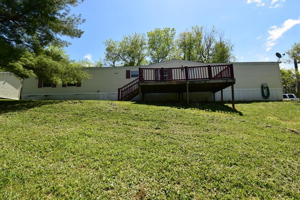 Great Location. This singlewide mobile home offers two bedrooms, two full bathrooms, with a Large Master on-suite with soaking tub and separate shower. The large open living-room has laminate flooring and a stone fireplace with propane logs.  Exterior amenities include open decks, a 600 sq ft double garage and separate storage shed. Conveniently located between Galax and Hillsville.