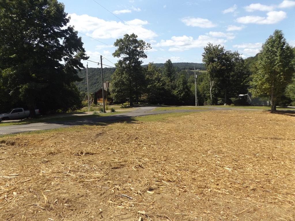 1.6043 +/- acre tract with nice building sites and Piedmont views in Crystal Springs Farms!  Lot features mature trees, paved road frontage, small wet weather spring on the rear of the property and nice views!   Don't miss out on this nice lot right off of the Blue Ridge Parkway and close to Interstate 77!