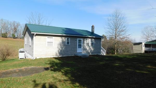 Here is a great property priced to sell! This property can be a country get away or a permanent home site. It has 4.86ac of mostly open land if you would like to start your own small farm. There is also a pond on this property and would be great for stocking with fish, as at one time was stocked. There are storage sheds on this property for plenty of storage. There is 1008 sq. ft. heated house with a 1008 sq. ft. basement house on this property. The house has a 5 rooms total, 2 bedroom, 1.5 bathrooms, kitchen and living room. The house also has a full 1008 sq. ft. basement and was recently painted, floors and walls. There is a wood stove for additional heating in the basement to compliment the HVAC unit to help save electricity costs. There is also a metal carport at the rear of the house.