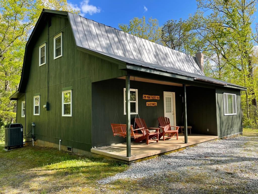 38.99 acres and cabin in Lambsburg Va. Home features: 1248 sq. ft., 3 bedroom and 2 bath. On the main level you have a living room with a wood burning stove, dining room, kitchen that goes out to an enclosed back porch, bedroom and bath. On the upper you have 2 bedroom and 1 bath. Home comes partially furnished. Land features: Beautiful views of the mountains, barn, half wooded,  half open pasture, some fencing and a detached garage. Great location - 15 minutes to the Blue Ridge Parkway or to Mt Airy, NC. Within 4 miles to I-77. 36.7 acres can be sold separately at $139,000.