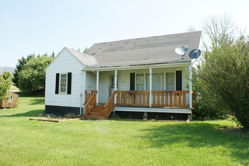 Let yourself be drawn into this home by beautiful red oak hardwood floors.  Take note of the large eat in kitchen.  Plenty of room to allow family to congregate and help Mom cook meals to be shared.  Large living room with picture window for viewing surrounding countryside.  Nice front porch with plenty of room for family time.  Two roomy bedrooms and bath downstairs.  Potential third bedroom/master suite upstairs.  Full basement.  Just a short walk into town to enjoy activities in the area.  This home has tons of potential.  Call us today to schedule an appointment.