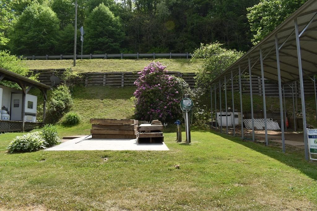 """Room for 2 on the New!  Finally on the market after almost 2 decades, 2 permanent lots on the highly desirable New River, located on the NC/VA state line on the New River, between two sweet small towns, Independence, VA & Sparta, NC, the New River is home to a lot of family fun! Best location on the New River in the mountains, it's broad & slow with some deep pockets full of fish! One lot is under cover with an 18'X40' shelter + there is an additional lot with a 12'X26' concrete pad for another camper. Power for both is between the lots, 1-30Amp, 1-50 Amp & 1-110V outlet, there are separate sewer connection and they have 1 new water line. You have a deeded easement to riverfront for """"recreational purposes"""" without the maintenance of the riverfront!  The HOA takes care of mowing & road maintenance, trash, water & sewer lines, you pay your annual dues & get away to enjoy this iconic campground, enjoy the cooler temps, fresh air and fun on the New River."""