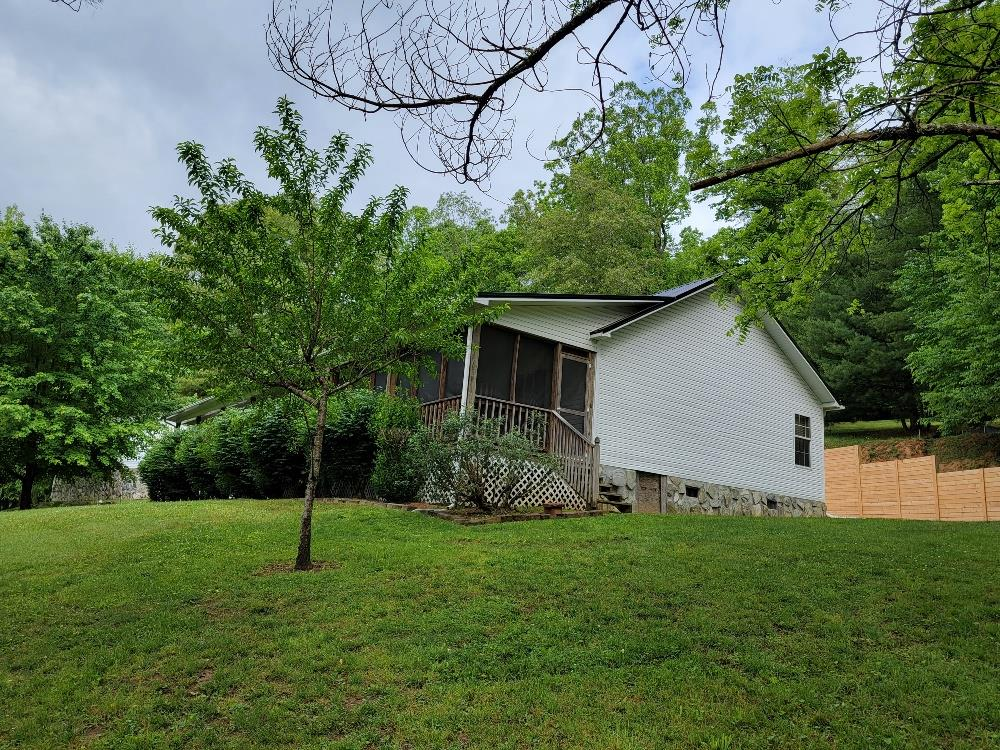 Spacious 3 bedroom 2 bath home overlooking the New River in Grayson County on 1.73 acres with a creek! This gorgeous vinyl sided home features a new metal roof in 2018 and new heatpump in 2021, large living/dining area, beautiful kitchen & appliances convey.  huge master bedroom and bath with soaking tub and walk in closet. Enjoy the outstanding views from the 10' x 70' covered front porch, partially screened in. Very nice  43' x 30' 3- bay garage with 30 amp hookup for camper,  extensive landscaping, paved driveway, 20' x 24' outbuilding and the list goes on.  Great location just between Galax & Independence and within minutes to the public boat landing on the New River.