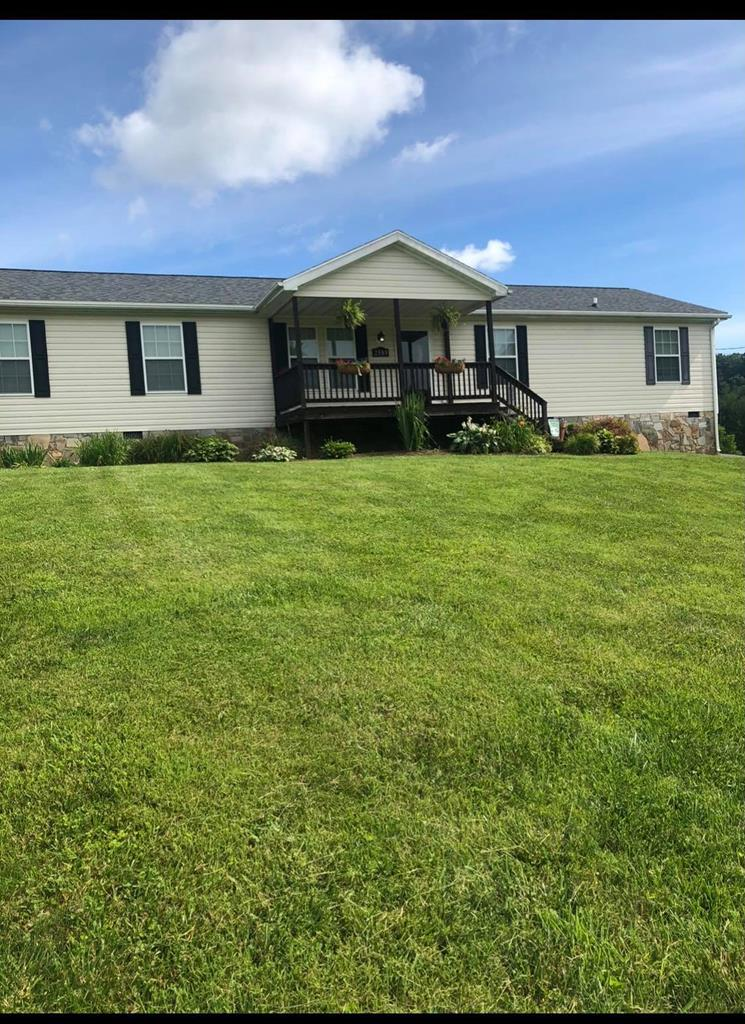 This beautiful one level ranch style home is just down the road from the Little Country Store on Pipers' Gap and 10 minutes from Galax.  This home with a view has 4 bedrooms and 2 baths and features a living and room and den (with gas fireplace) and a nice kitchen with an island. Master Bedroom has a walk in closet that is 13 feet long and enters into the master bathroom. The master bath is huge and includes a garden tub!  Out front is a 26 foot covered porch and 50' plus deck on the rear for all your outdoor grilling and country viewing.  This home sits on over half an acre (roughly .69) and is being sold with adjoining lot (over another half acre) included in the price. Give us a call today!
