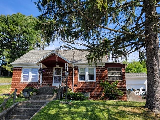 Great Galax City Location! 3 bedroom 2 bath brick home on a quiet street in town. This home is in move-in condition and features updated kitchen cabinets and countertops, and all major appliances, hardwood, tile, and new carpet flooring, two bedroom, two bath, dining room, and large laundry room/office all on the main level. Upstairs you will find a bedroom and loft. Home also has a basement & one car garage and covered back porch. Enjoy what this home has to offer and only minutes to schools, shopping and the hospital.