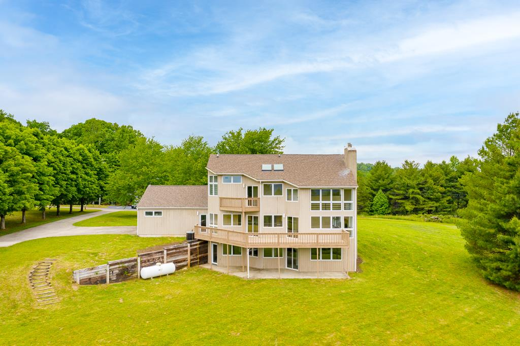 Very large 3 level home on 9.4 acres just off the Blue Ridge Parkway in Virginia.  So much potential for large family, family retreat, vacation home and/or rental.  Lots of glass throughout to enjoy all the amazing views. Look at floor plan. Main level has kitchen with eating area, dining, living, Bedroom, bath, laundry with shoot from upper level, and 2 car garage.  Huge deck as well as covered porch. 2nd level has Master Suite with skylights and Ensuite with jet tub, private Balcony and really cool catwalk overlooking lower level and great lookout over the land. 2 guest bedrooms & bathroom. Also a sitting room/office. The basement is all finished with huge family room and other side could be bedroom with closet & full bath. Not totally walled. Sq ft is estimate and probably lower than actual as hard to measure. Priced below assessed value. Jump on the Blue Ridge Parkway and discover everything this wonderful area has to offer. Be sure to see 3D tour to walk through home virtually.