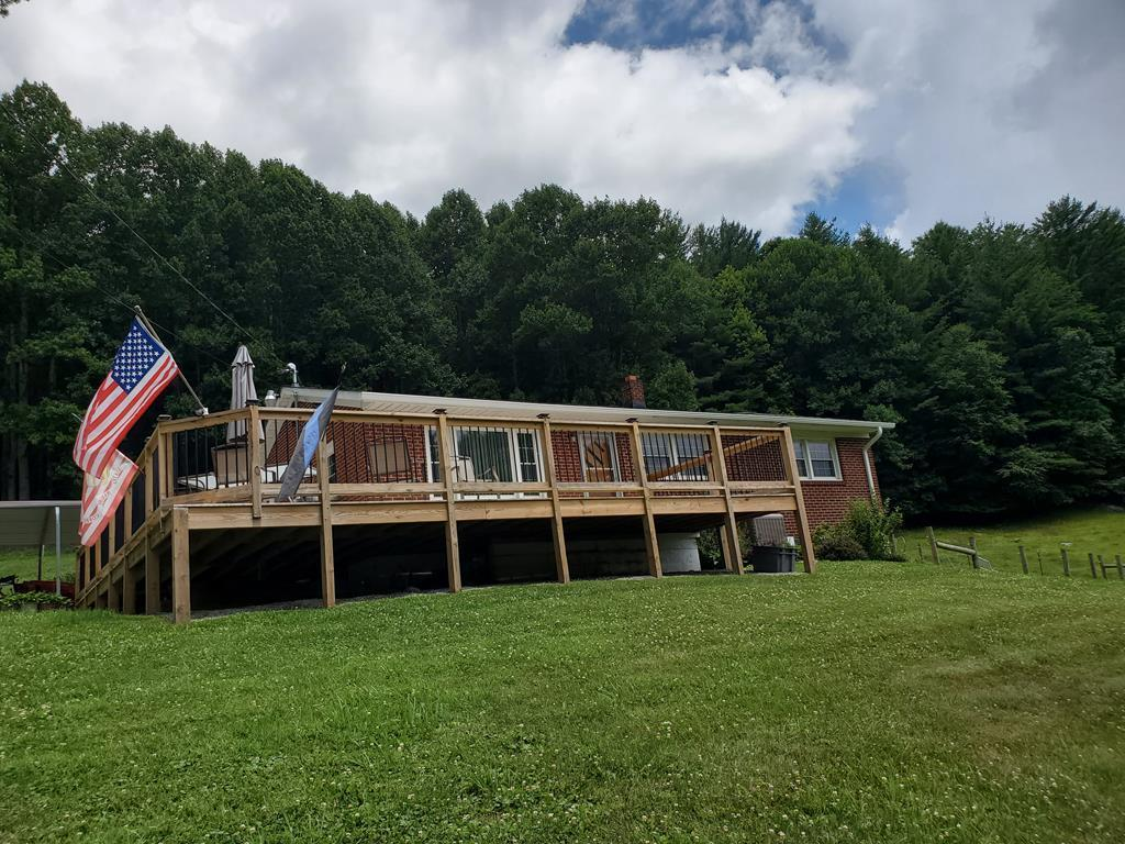 Looking for your mini farm? Here it is! Located in Troutdale VA. Remodeled in 2008. Brick ranch home with full basement and 13 acres of land. Home has brand new heat pump installed in 2021. Basement sealed for water protection in June 2021. New 12x54 deck built in summer of 2020. Outdoor wood burning stove, barn, shed, partial fenced in pasture for animals and chicken pen.  This property is close to National Forest, horse camps, camping, Hungry Mother State Park and Grayson Highlands State Park. The Appalachian Trail is just minutes away.