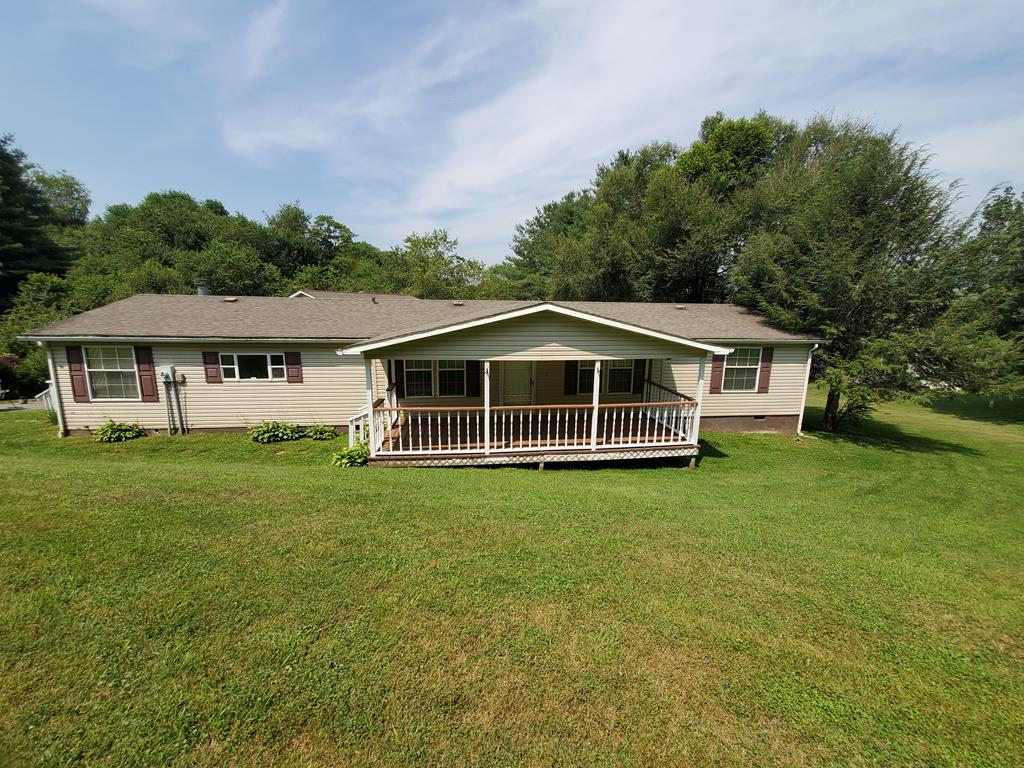 Check it out!  Beautiful and well taken care of 3 bed, 2 bath home right outside of Independence.  Home has beautiful fireplace, living room and family room, dinning room and eat in kitchen.  Covered porch on front of house, back porch and side porch are open.  Huge 2 story garage with parking for 2 vehicles.  Upstairs in garage can be made into an apartment with ease giving extra income if wanted.  Come enjoy the quietness and all it has to offer.