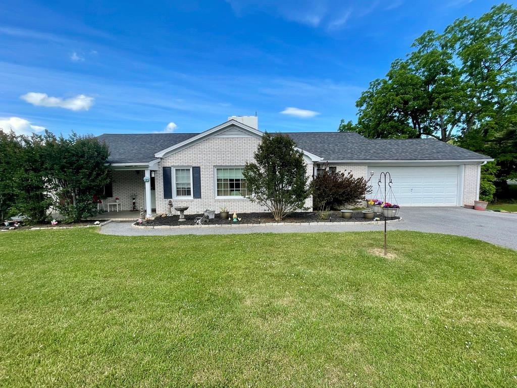 Great home in a great location!  On the main level you will find a large living area, kitchen/dining area, a formal dining area, two large bedrooms, two bathrooms, covered front porch, a small deck, and an entrance to the attached two car garage.  In the full walk out basement you will find a third bedroom , a large den area and family room, an entrance to the concrete patio, several large unfinished areas that would be great for storage or a work shop.  On the outside you will find a covered front porch, a paved drive, detached garage, concrete patio, and it sits on a corner lot minutes from downtown!