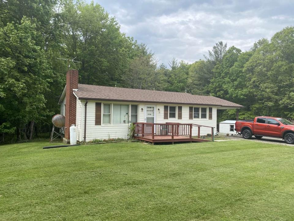 With all needed amenities on the main floor, this home provides great one level living!  With a vinyl siding and replacement windows, maintenance free becomes a life style.  Large outbuildings provide storage area for lawn mowers, equipment or all the toys.  Come quick!  It's hard to find a good home for this price now a days.