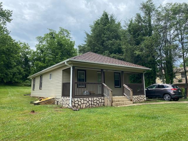 Fully renovated home in a prime Galax location! This 2 bed / 2 bath bungalow is completely move-in ready and would make a wonderful starter home or retirement home for those wanting to downsize. Featuring an open floor plan, the living room flows nicely to the dining area which is open to the kitchen. Kitchen includes newer cabinetry and countertops with stainless steel appliances. A master suite is situated off the living area with a full bath and generous closet space. A second full bath and a second full bedroom round out the living spaces. A laundry / mudroom is off the back of the house and opens to a small covered patio and large, flat backyard. The inviting covered front porch and ample front yard make this home a true gem. Less than 5 minutes to schools, shopping and recreation, don't let this one pass you by!