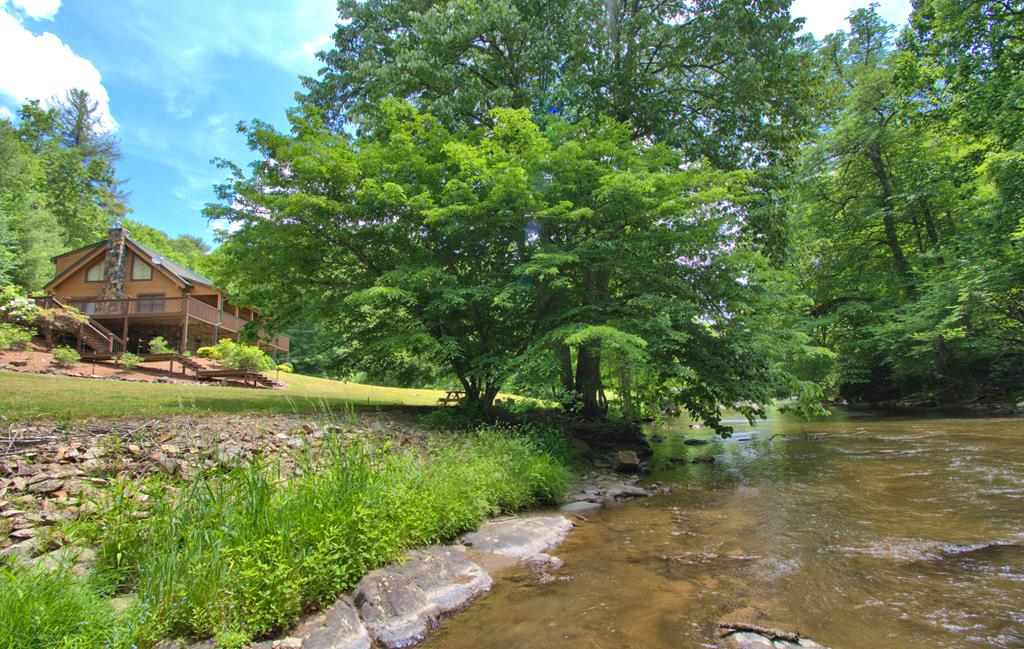 ONE OF A KIND MOUNTAIN PROPERTY! A sportsman's paradise in this truly unique property in the mountains of Southwest Virginia. Long private frontage on Fox Creek, 63 acres of privacy and abundance of wildlife, along with a 3-bedroom, 2-bath Old Virginia log cabin, equipment shed, and old barn contribute to the ultimate mountain living experience. Enjoy the sights and sounds of the creek from the partially covered wrap porch with no houses or people in sight. The main level offers a vaulted great room with gas log fireplace and wood floors, 2 main level bedrooms & full bath. Upper level has spacious loft area, large bedroom & full bath. Full walk-out lower level with wood burning stove offering expansion potential & lots of storage or workshop space. Lovingly landscaped, garden space, and nice firepit and picnic table at the creek. Easy access to the creek for fishing, tubing, or simply cooling off.