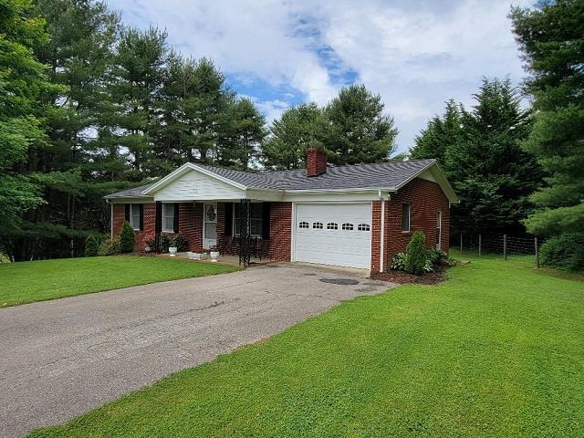 Country living at it's best! Beautiful brick ranch home located in the Woodlawn community of Carroll County on a quiet rd. . Features include: 3 bedroom 1 bath & 2- half baths, new roof in 2020,  coverered front porch, full walkout basement,  1 car carpot, paved driveway, outbuilding and much more!