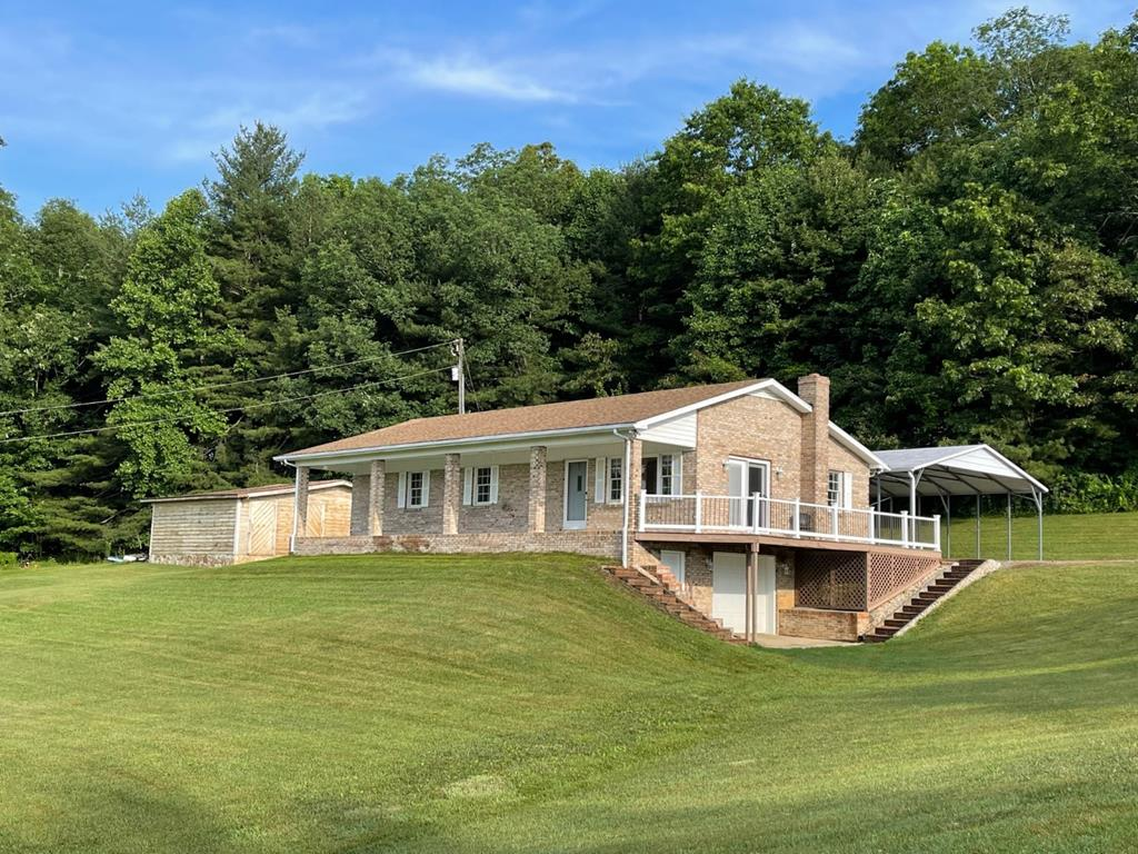 Nice private brick home on 23+ acres with 1964 bordering the Blue Ridge Parkway. Property borders Stewarts Creek.  Also 265 of frontage on Coleman Lane. Partially fenced, Country Side & Parkway Views, Pasture Land and Woods for hunting. Home features: 1326 sq. ft. 3 bedroom, 2 baths,  new paint throughout, open living  & dining room with hardwood flooring & French doors out to the deck, kitchen has tile flooring, oak cabinets and granite counter tops, master bedroom has hardwood flooring  and 2 walk in closets, master bath has tile flooring, oak cabinets, granite counter tops and a jetted tub, 2 additional bedrooms with carpet and another bath with tile, oak cabinets and granite. There is also a attic for storage. On the lower level you have a large basement with extra space under the porch and an insulated garage door for an easy entrance. There are 872' of trex decking to enjoy the scenic view and wildlife.