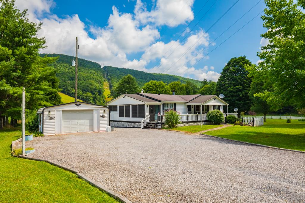 This remarkable property has it all, including a garage, bunk house, and gazebo, but also comes with lots of opportunities for personalization. Perfect for the outdoorsman or hobbyist, the multiple outbuildings offer you a chance to capitalize on the large amount of storage or convert one of them into a hobby shop, man cave, guest cabin, and more. The level lot boasts fruit trees, mature shade trees, and a border fence. A short drive from either Dublin or Bland via Little Creek, it simultaneously offers privacy and access to amenities. Schedule a showing and see what this property could be for you!