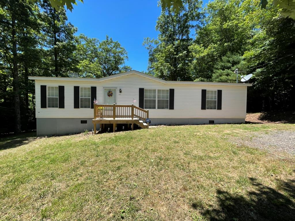 Very nice doublewide in High Chaparral Subdivision. Home features: 1352 sq. ft. 3 BR, 2 BA, Living room has a gas log fireplace and all appliances convey in the kitchen and laundry, 10' x 14' back deck for privacy. Home is in very good condition and affordable. Heat pump. Community water system. Located less than 1 mile to the Blue Ridge Parkway in Fancy Gap.