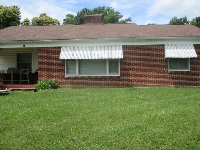 Brick ranch home in the Town of Independence.  Located at the top of a hill for excellent views.  3 bedrooms and 1 bath.  Partial basement.  Nice level yard in front and back.  3 large lots and part of a 4th.  Even though you are in Town no one can build right on top of you.  Out building.
