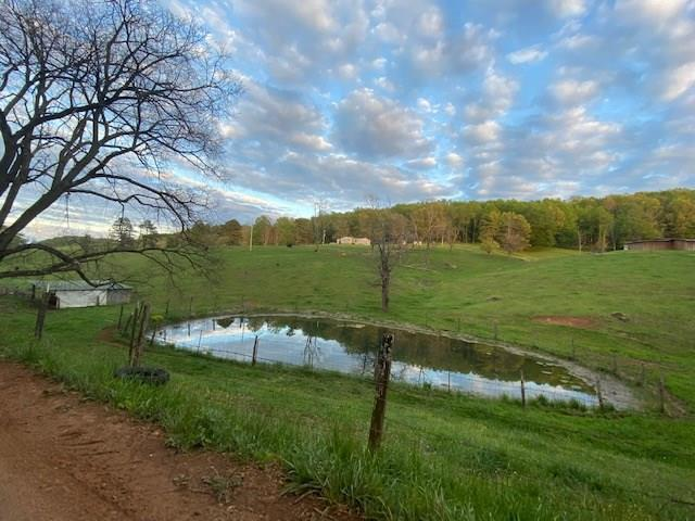 68 acres of beautiful farmland with a creek, 3 ponds and a total of 7 fenced areas and unbeatable views from just about everywhere on this property. 3 of the 7 fenced areas are pasture and the others are a good mix of pasture and sparse woods for the animals to shade in. 6 auto waterers concreted in, 2 more are movable. There is animal water access to just about every fenced in area of this property. Going through the entire 68 acres is a well maintained dirt/gravel road that you can drive a car through. This road will lead you to all the green gates accessing the fenced and cross fenced areas that would be perfect for just about any type of animal you would ever want. From one pasture area on the backside of the property you can see just the top of Mt. Rogers, and seller states when the leaves are off you have a clear view of the highest elevation in VA. 3BD/2BA doublewide with an open dining, living, kitchen and large master suite with walk-in shower and walk-in closet. 5 y.o. roof.