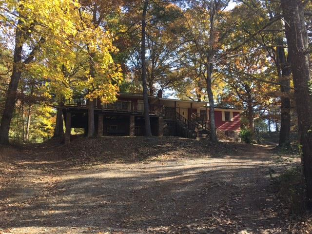 THIS 0.46 ACRES CONTAINS A 3 BEDROOM, 1 BATH HOME WITH 1080 SQ. FT.,  A BASEMENT, FAMILY ROOM, 920 SQ.FT. DECK AND 160 SQ.FT. FRONT PORCH. HOME SHOULD NOT BE ENTERED DUE TO SAFETY ISSUES. HOLD HARMLESS MUST BE SIGNED BY ANY PARTIES INTENDING TO ENTER HOME.  PROPERTY IS BEING SOLD AS VACANT LAND. DRIVEWAY IS VERY STEEP AND CAUTION SHOULD BE USED.