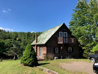 Cute cabin with spectacular views.  3.4 acres offer privacy yet in close proximity to Town.  Large master bedroom with a setting area and walk out balcony.  Rock fireplace with gas logs. Open deck.  Spacious Sunroom.  Out building.