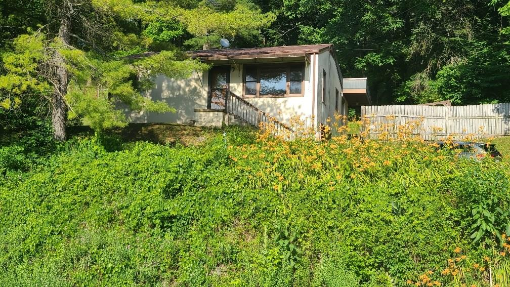"""Raised Ranch 2BR, 1BA close to the town of Chilhowie on 1.15 acres.  Some of the property is fenced in the back (owner had goats). Pull under garage. Property being sold """"as is, where is"""" with no warranties or guaranties expressed or implied."""