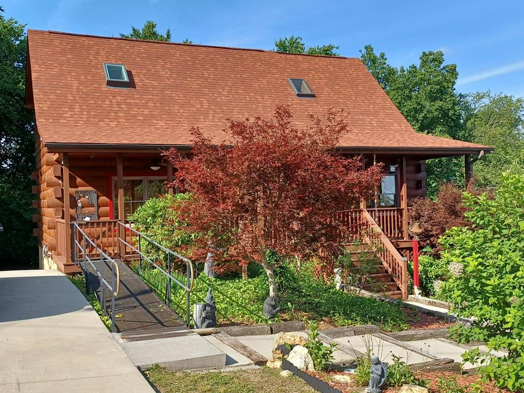 PIEDMONT VIEWS. This is a great opportunity to own a mountain home with views of Pilot & Suuratown Mountains. Lush landscaping welcomes you to this  Amerlink Log home built with a wide open great room concept, Room sizes are only to show how it is currently used. High vaulted ceilings make for a spacious feeling. The 2nd sleeping area is a generous open loft area with closet & full bath. There is a separate den/office/tv loft area. The walkout basement is plumbed for an additional bathroom and could be finished off for a large family/game room. Chalet High is a super community with paved roads, community water plus recreation facilities that include pool, tennis, gazebo, shuffleboard, duck/fishing ponds. Several new homes being built by folks who discovered this hidden gem of a community located just off the Blue Ridge Parkway. 6 minutes to Fancy Gap, 20 minutes to Hillsville or Galax, 25 minutes to Mt. Airy, NC. Buyer to verify internet availability w/ Century link or Fast Link