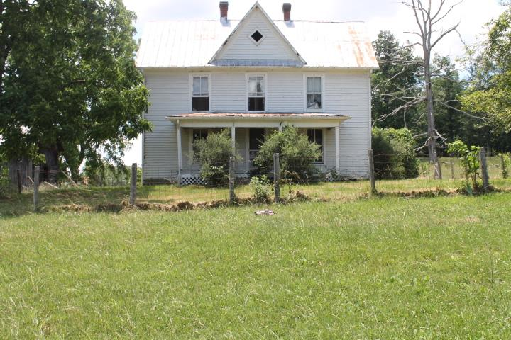21.6 ACRES OF LAND WITH A OLD TWO STORY FRAME HOME  WITH APPROX. 2000 SQ. FEET, LARGE TWO STORY BARN, WOOD SHED, AND TWO OTHER SMALLER BARNS, THE LAND IS APPROX. 95%OPEN BALANCE IN WOODS. THERE IS A GOOD BOUNDRY FENCE, AND SOME CROSS FENCING..COUNTY WATER IS AVAILABLE.
