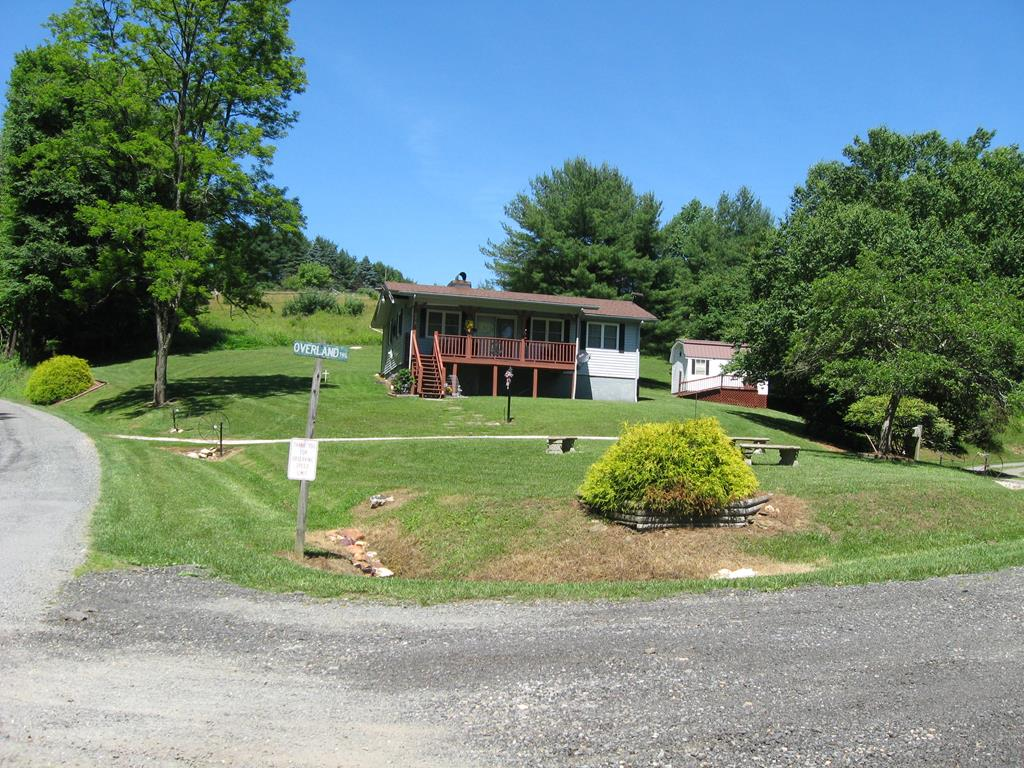 COZY TWO BEDROOM, ONE BATH CABIN VERY NEAR THE BLUE RIDGE PARKWAY AND MOVE IN READY WITH ALL APPLIANCES AND FURNISHINGS INCLUDED. THE BRICK FIREPLACE HAS A WOOD BURNING INSERT WHICH WILL HEAT THE CABIN, BUT THERE IS ALSO CENTRAL HEATING AND AIR CONDITIONING.  HOA FEE IN HIGH CHAPARRAL FOR PART TIME RESIDENTS IS ONLY $150/YEAR AND INCLUES CENTRAL WATER AND ROAD MAINTENANCE.  FEE INCREASES TO $300/YEAR FOR FULL TIME RESIDENTS. NICE SHED WAS ADDED IN 2014 FOR YARD EQUIPMENT AND STORAGE AND A NEW ROOF WAS INSTALLED ON THE CABIN AT THAT TIME. THIS ONE WON'T LAST LONG!