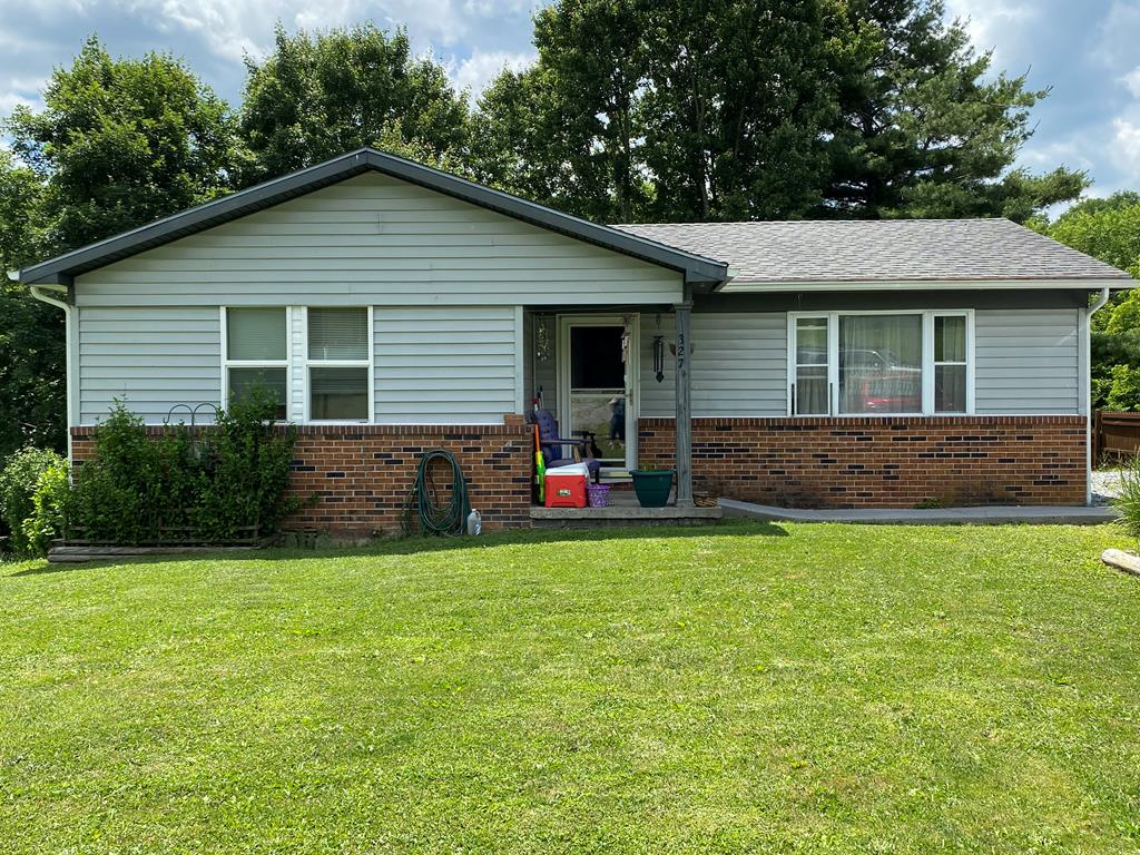Cute! Cute! Cute! This house is located in Rolling Hills subdivision outside of town limits. The home features 3 bedrooms and 1 bathroom.  It would make a great starter home. There is a deck out back as well as an out building. Call for your showing.
