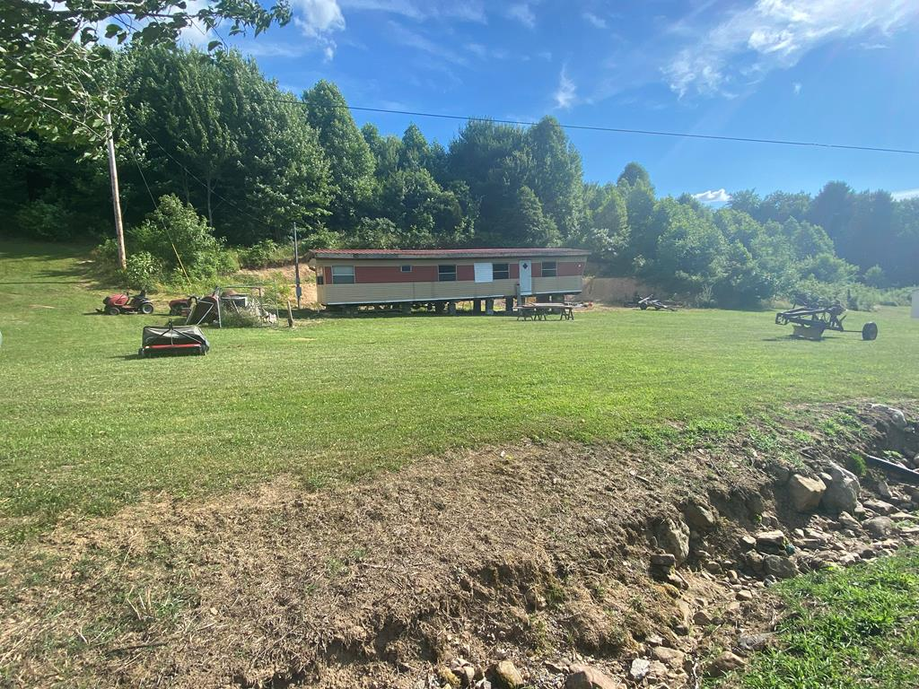 Ready, set, build! Nice FLAT building lot with older mobile home on property. Brand new septic tank and public water in place. Newer land survey on file. Great location in the county, no town taxes!!