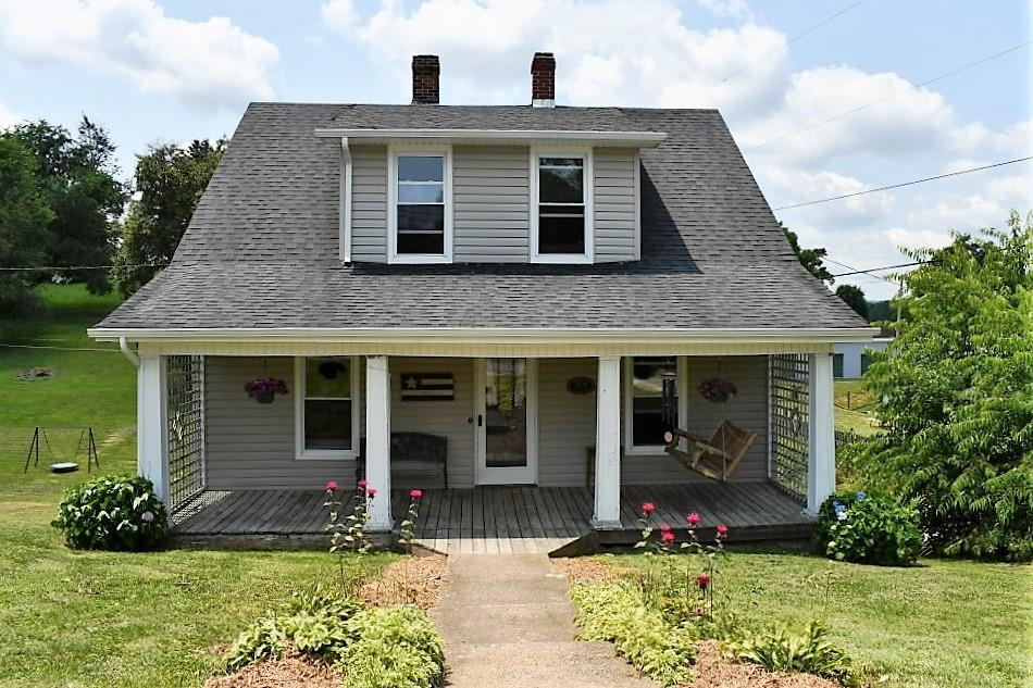 3 BR, 1.5 BA, 1067 Sq. Ft. home for sale in Rural Retreat, VA.  This lovely, solid built cape cod style home offers hardwood & tile flooring, newer paint, newer vinyl siding as well as a brand new 26.5' X 15' deck on the back of the home.  You will find the master bedroom on the main level with a full bath.  The wooden staircase takes you upstairs to the 2 nice size bedrooms with dormers, 1/2 bath and plenty of  storage for all of your extras.  In the kitchen you will find all hand constructed cabinets made from beautiful wormy chestnut with solid surface countertops.  The living room has ample space for your family and friends to gather, leading into the dinning room with sliding glass doors that will open to the immense deck where you can do all of your outside entertaining!  The laundry is located in the unfinished basement where you will also find additional storage space or create your own space for a workshop or hobby room.