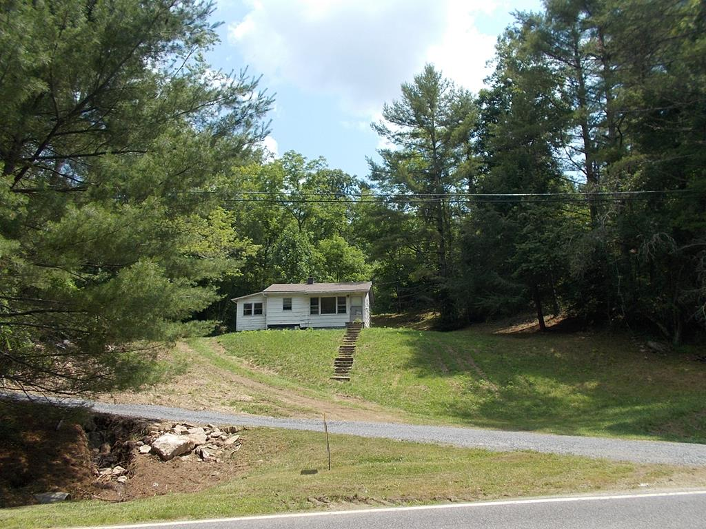 FIX UP SPECIAL!  A GREAT LOCATION NEAR THE NEW RIVER AND NEW RIVER STATE TRAIL, FRIES. 1 mile from the public boat landing and park.  House needs work but could be a nice cabin or weekend home for the do it your self person.   Hardwood floors, sheetrock walls.  Property is being sold as-is.  Property includes 2.489 Acres of woods, except the yard.  You can smell and hear the sounds of the surrounding woods and a small spring-fed stream running thru the edge of your yard.  Buyer to determine internet options.   Property has a well, but is not currently connected to the house. Seller is having a new breaker box installed.