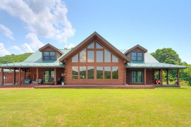 Exquisite, Custom Built Log Home with incredible views on 89+/- acres with a 2+ acre stock pond. This spectacular home boast 4500+/- sq.ft and features open concept living with cathedral ceilings, stone fireplace, hardwood flooring throughout, wormy chestnut doors, gorgeous kitchen with wormy maple cabinets and lots of counter space. Main level features spacious living /dining area with large windows allowing lots of natural light, master bedroom and bath with walk in closet, sunroom overlooking pond, indoor jacuzzi, full bath and laundry room. Second level offers 2 bedrooms and full bath, large loft and sitting area. Enjoy the privacy this farm offers from the wrap-around porch taking in the long distant mountain views, two car garage, whole house generator and solar panels. Land features a mixture of fenced pasture and hardwoods & loaded with trophy size wildlife. Great place for horses & cattle.  Great location with easy access to I-81.
