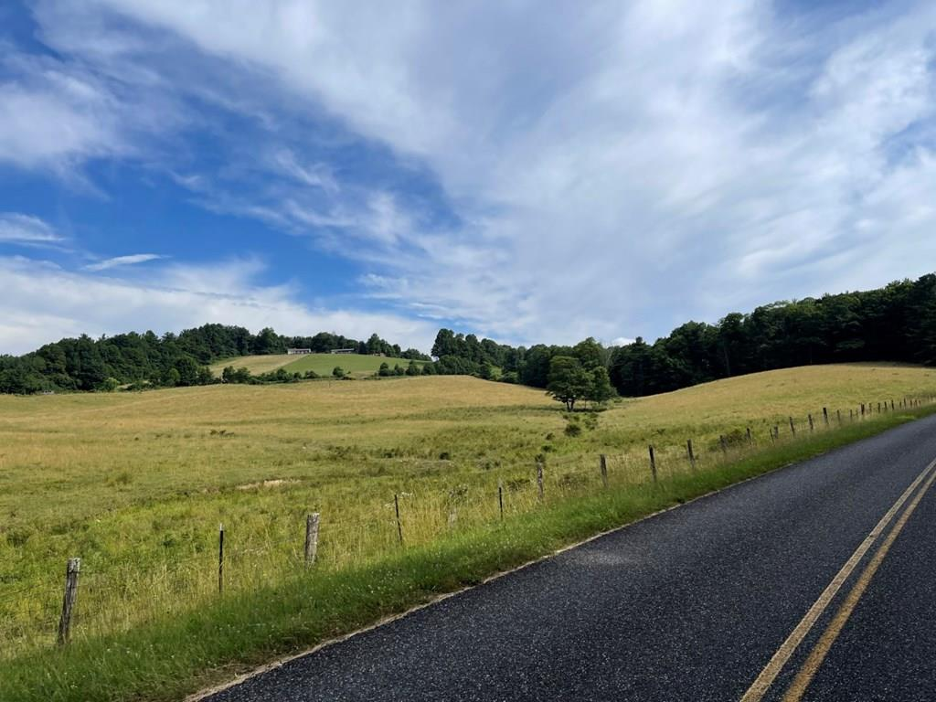 23.42 acres of desirable pasture land with a creek running through it. Level, sloping, open and fenced. Beautiful country side views. Land is adjacent to Blue Ridge Parkway, less than one mile to highway 52 and I-77.