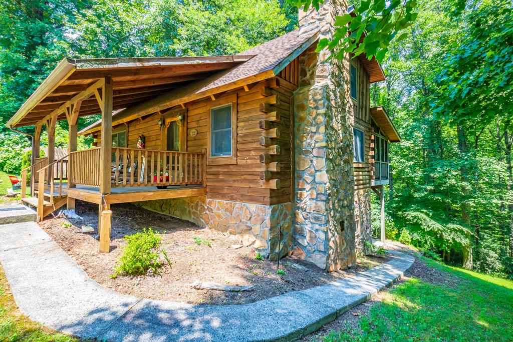 """This beautiful log home is in the gated community of Cascade Mountain Resort. You're just off the Blue Ridge Parkway. This home is move in ready, and has had  renovations done recently. You have new upscale stainless steel appliances. This home is move in ready! The beautiful log beams are exposed and visible from the main level as well as the loft area. You have 3 different entertaining rooms. one for each level. The laundry is in the closet of the main level bathroom. There is also a 36' X 11'3"""" screened in back porch, and a 24' X 8' covered porch as well. This home is in a peaceful location nestled into the woods. The annual dues here are $650, and include water, a new swimming pool, a tennis court, basketball court, fishing ponds, clubhouse and over 30 acres of common area. The pool house is currently being renovated as well. You are just an hour from Winston Salem, and less than 30 minutes to Hillsville and Mount Airy for shopping. The basement bedroom doesn't have a window."""
