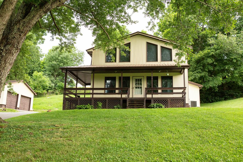 Back on the market due to circumstances not related to the home. Sought after Chilhowie Schools!  Situated on 0.78 +/- acres this 3-BR 2- BA home offers a great patio with a beautiful retaining wall complete with fire pit and privacy, 2 completely renovated baths, newer roof & gutters. The large open great room has a cathedral ceiling which is open to the loft balcony, the perfect place for a reading area, an office, or virtual learning. The den has a wood burning stove for those chilly days and nights to set by the fire or as a backup source.  There is a large 2 car detached garage and a paved driveway.  Priced to sell come see this cute home, in the country but only minutes from I-81 - Churches - Schools - Shopping - and Dinning, before its gone!