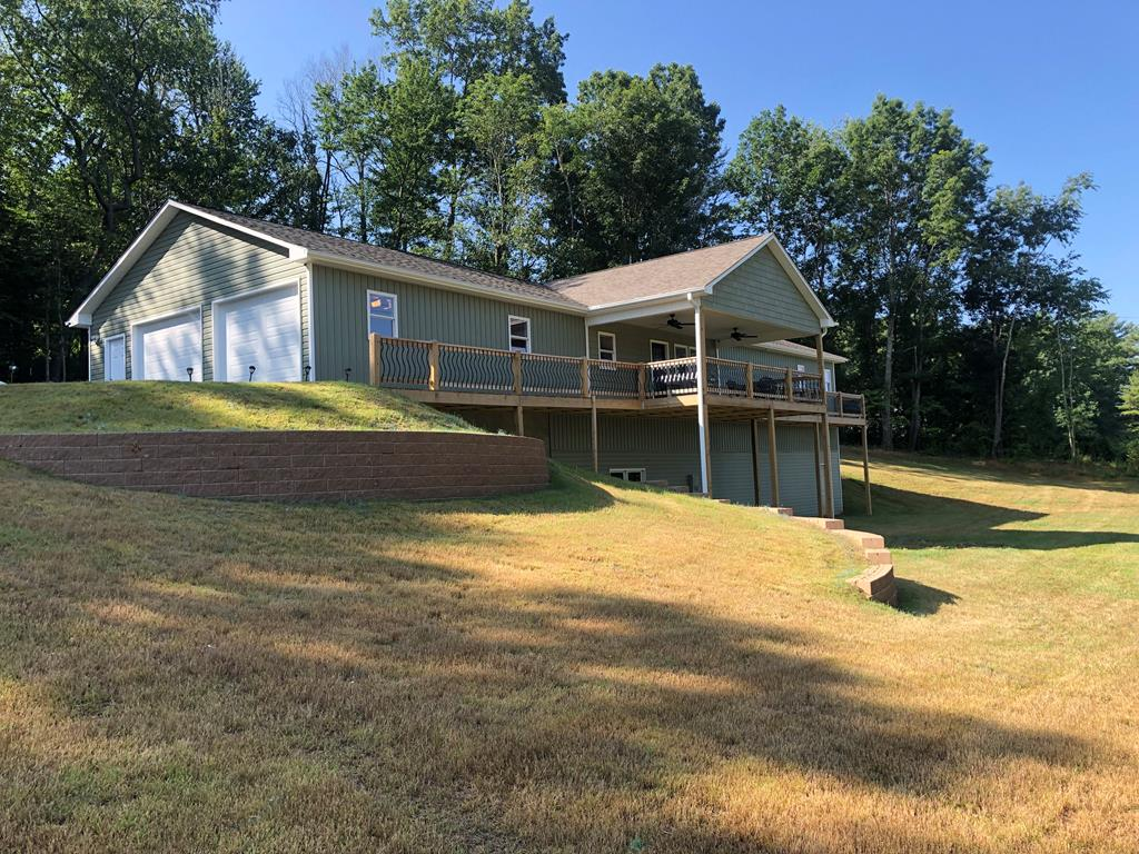 Beautiful home built in 2020 on 3.8 acres located in Hillsville. 2,000 finished square feet, two car garage, huge master suite with tile shower and jetted tub. Built-in bookcases and entertainment center. Granite countertops throughout, enormous kitchen, open concept, second room on main floor could be a second bedroom. Huge walk in closet. 1 more bedroom and I bath just finished downstairs. Room for more! Beautifully landscaped outside with covered back patio for entertaining. Must see to appreciate this beautiful home!