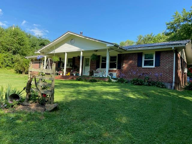 Here is your chance to own your own small escape from the hustle bustle.  This 3 bedroom brick ranch has 3 bedrooms, 2 baths, open Living room, dining room and kitchen with laundry upstairs and full basement.  Home has new kitchen, updated master bath and many more improvements. Home sits on over 9 acres of property that is part wooded for hunting and part open for the animals.  There is a small stream on the property along with a large garage building with electric that could also be made into a barn. Another nice outbuilding conveys as well along with a chicken coop if wanted.  This property is located just out of town with wildlife abounding so it is convenient for everything.